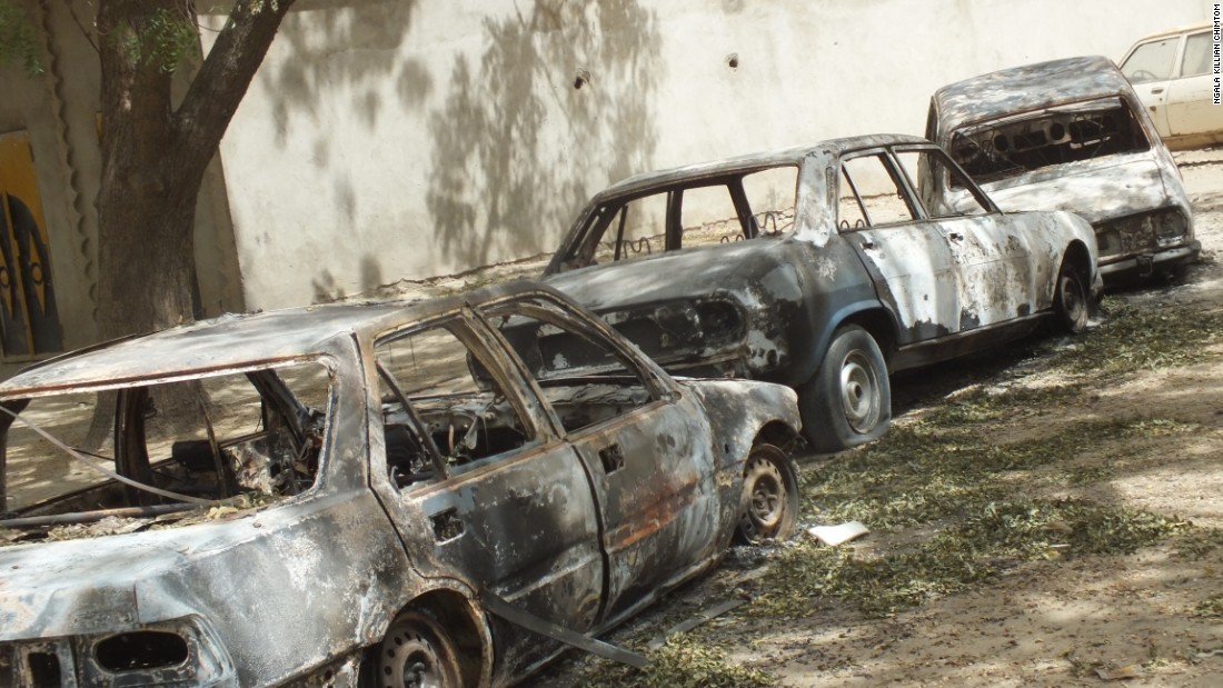 Burned-out cars line the streets of Fotokol, Cameroon.