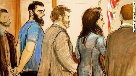 In this January 2013 file image, Abid Naseer, second from left, is arraigned in Brooklyn Federal Court.