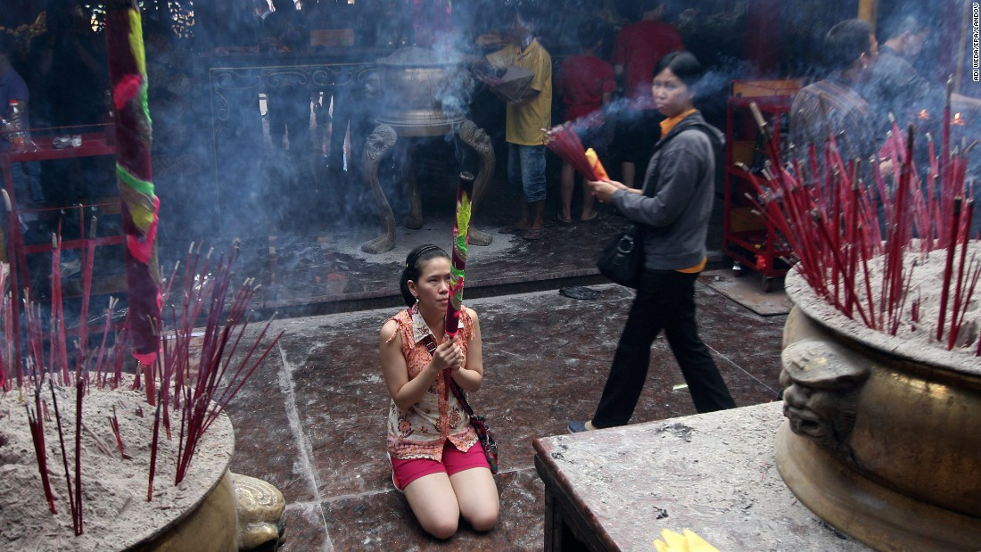 A woman prays at a temple in Jakarta, Indonesia, on February 18.