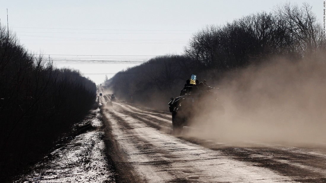 A Ukrainian armored vehicle passes on a road stretching away from the town of Artemivsk towards Debaltseve on February 17.