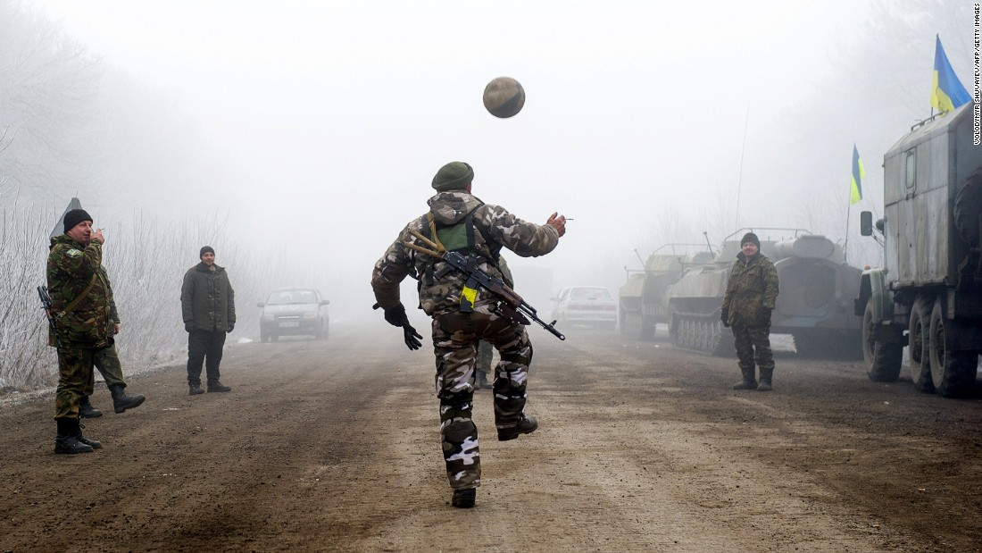 "Ukrainian servicemen play football on a road in Svitlodarsk approaching Debaltseve on February 15. <a href=""http://cnn.com/2015/02/15/europe/ukraine-conflict/"">The ceasefire went into effect after midnight,</a> followed by brief accusations of violence."