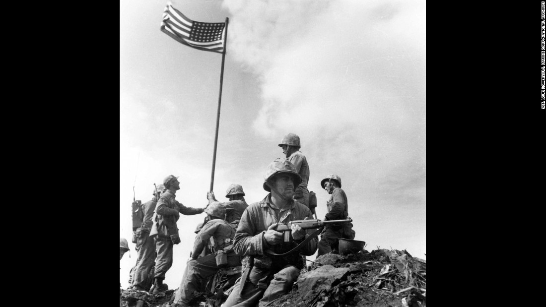Marine Sgt. Louis Lowery, a photographer for Leatherneck magazine, captured this image of U.S. Marines raising an American flag for the first time atop Iwo Jima's Mount Suribachi on February 23, 1945. A strange series of events, however, made this photo less well-known than Rosenthal's.