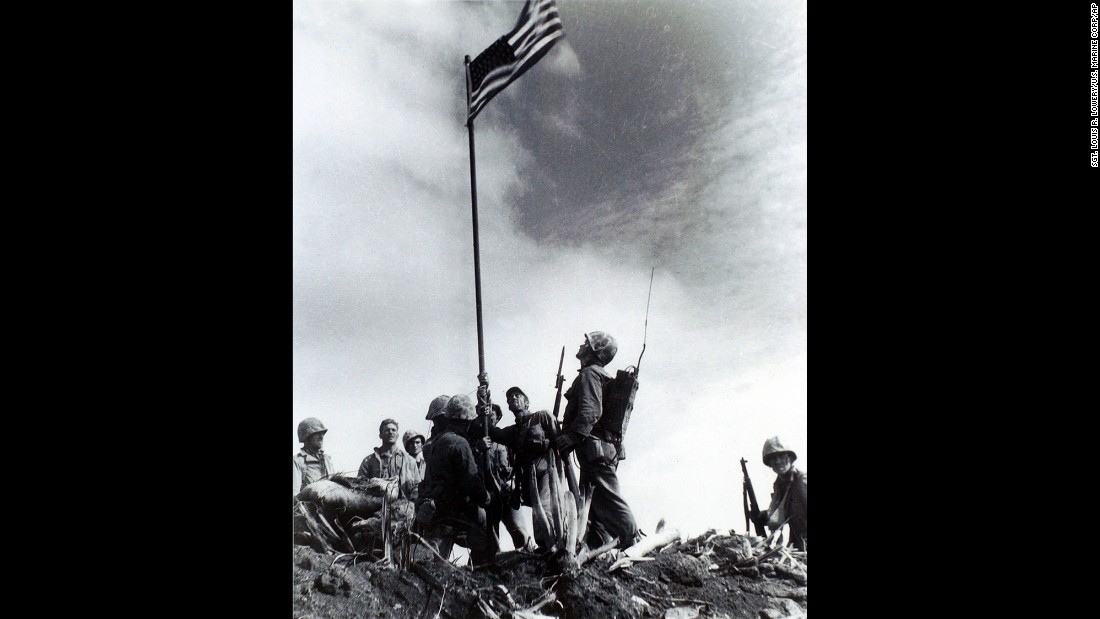 Another Lowery image of the first flag-raising. A short time later, the Marines were ordered to replace the first flag with a bigger one so more people could see it.