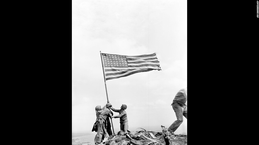 Rosenthal took this image of three men holding the flagstaff. During the flag-raising, the area was still a dangerous combat zone. Japanese soldiers were hiding throughout the island.