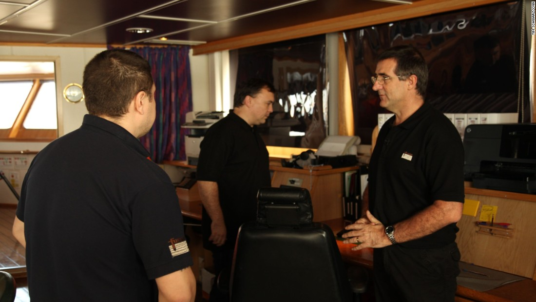 Party Chief, the official title for the person in charge of the survey, Chris Morris (left) talks with Captain Vladimir Konstantinov (center), who has skippered the Discovery for the past six weeks.