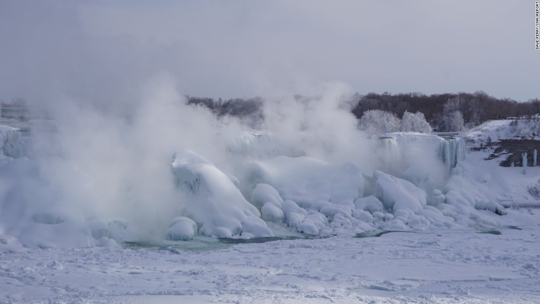 "Perry and <a href=""http://www.cnn.com/2015/02/19/travel/feat-great-lakes-niagara-falls-frozen/index.html"">dozens of tourists</a> from America and Canada are making their way to see the frozen scene."