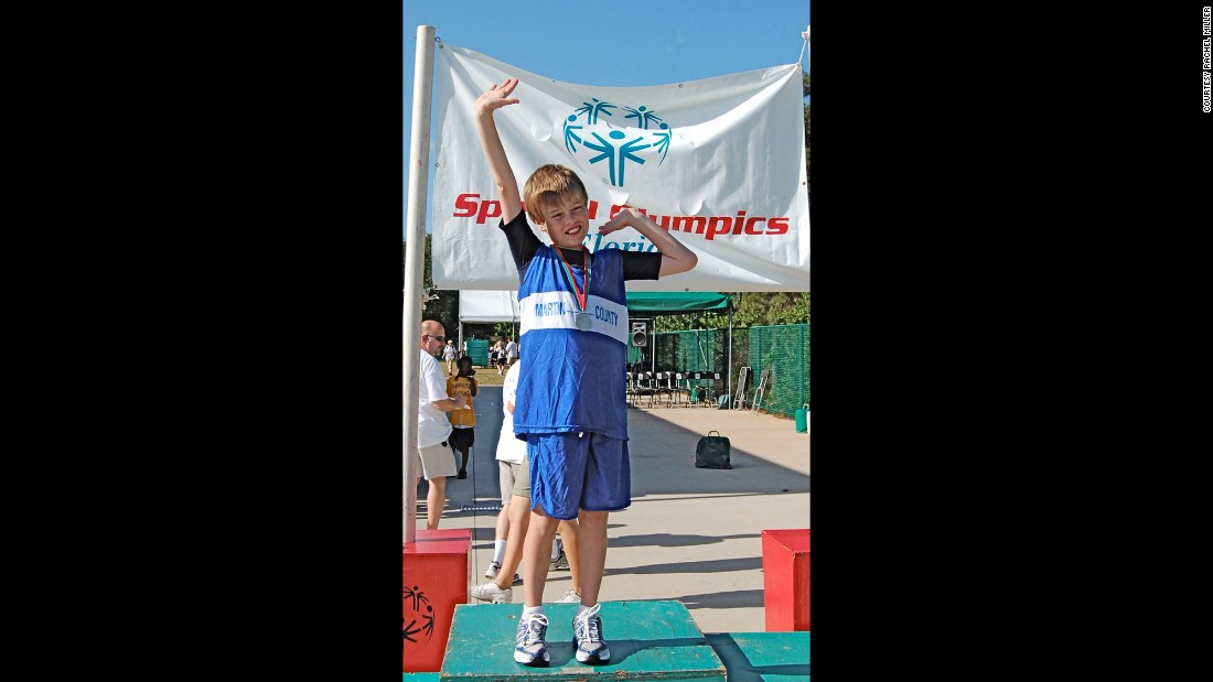 Here, a 12-year-old John shows off his first-place medal for the 100 meters at the Special Olympics Summer State Games in 2008.