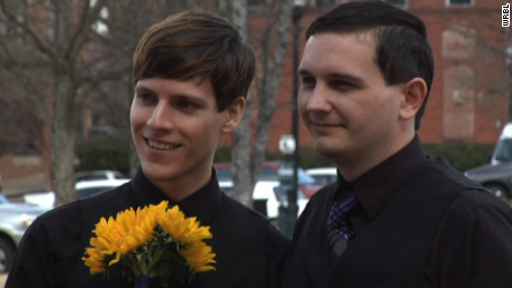 Same sex couple marries in front of courthouse