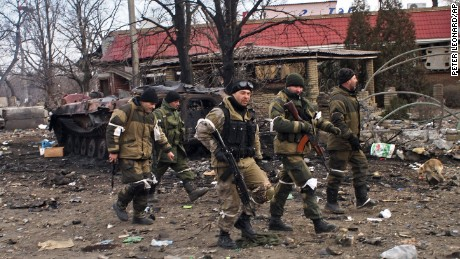 Pro-Russia rebels walk in Debaltseve, eastern Ukraine on Thursday, Feb. 19, 2015. After weeks of relentless fighting, the embattled Ukrainian rail hub of Debaltseve fell Wednesday to Russia-backed separatists, who hoisted a flag in triumph over the town. The Ukrainian president confirmed that he had ordered troops to pull out and the rebels reported taking hundreds of soldiers captive. (AP Photo/ Peter Leonard)