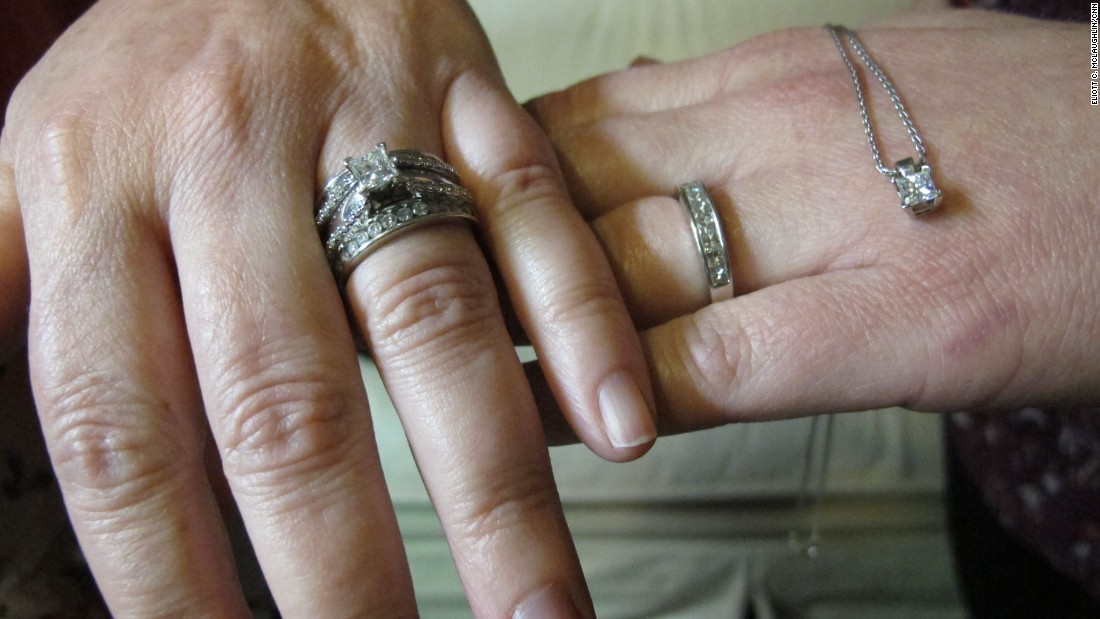 With no traditions in place for same-sex marriage, Lisa Carmichael and Meredith Miller proposed to each other at separate times in 2009. Miller gave Carmichael a more tradition ring, but because Miller doesn't care for rings, she got a smaller band with a solitaire matching Carmichael's dangling from a necklace.