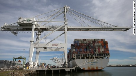A container ship sits docked in a berth at the Port of Oakland last week in Oakland, California.