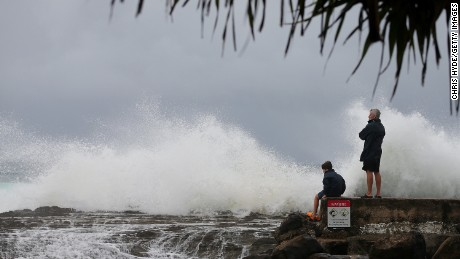 GOLD COAST, AUSTRALIA - FEBRUARY 19: People watch waves at Snapper Rocks as Cyclone Maria approaches the coast of Queensland on February 19, 2015 in Gold Coast, Australia. Cyclone Maria is a category 4 storm expected to hit central Queensland between Mackay and Gladstone early Friday morning. (Photo by Chris Hyde/Getty Images)