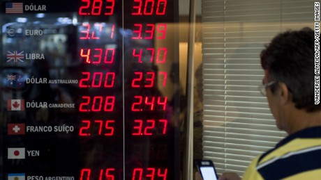 The foreign currency board of a bureau de change in Rio de Janeiro, Brazil, on January 11, 2015