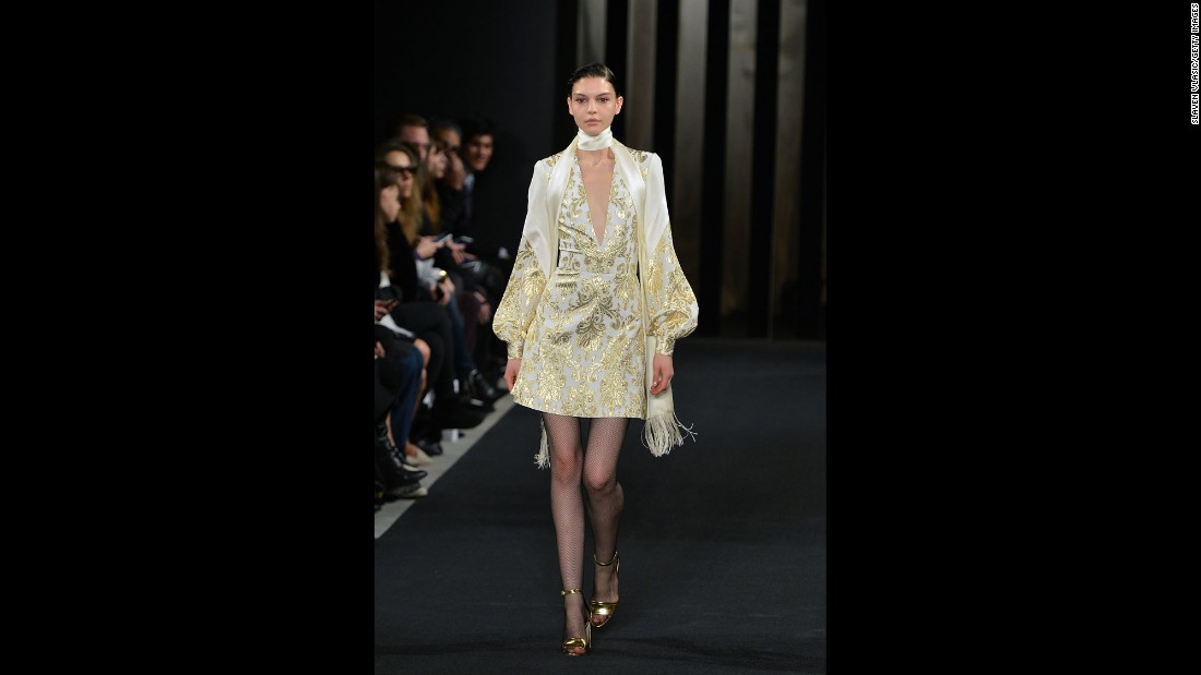 "J. Mendel's collection embraced fall's <a href=""http://www.cnn.com/2015/02/13/living/feat-nyfw-fall-2015-forecast/"">1970s trend</a> with skinny scarves and gold jacquard."