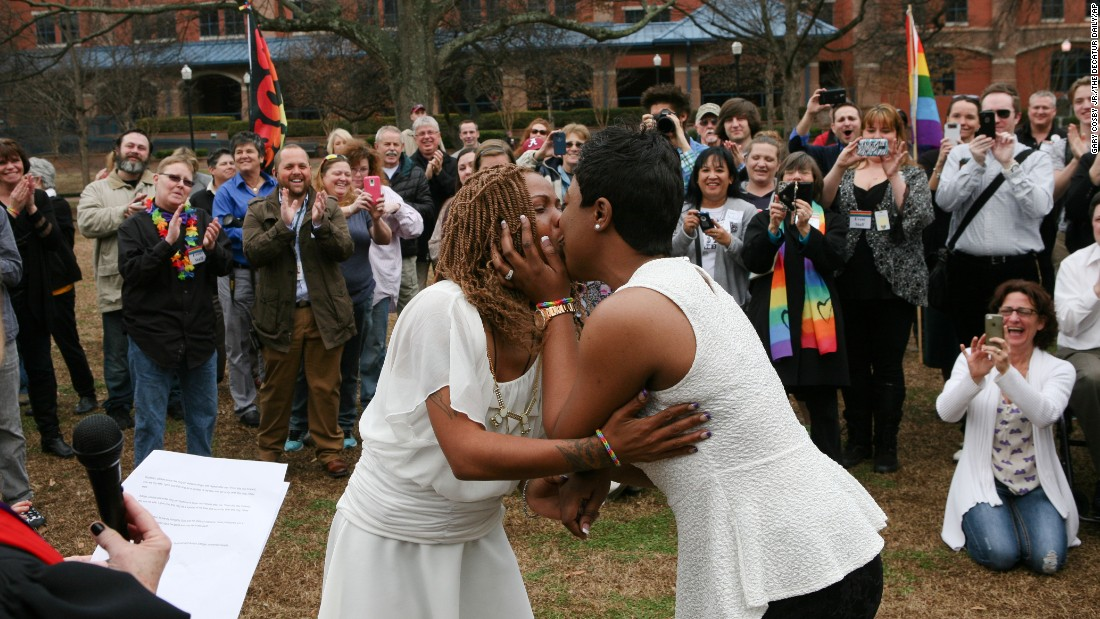 Yashinari Effinger kisses her spouse, Adrian Thomas, as they are declared a married couple in Huntsville, Alabama, on February 9.