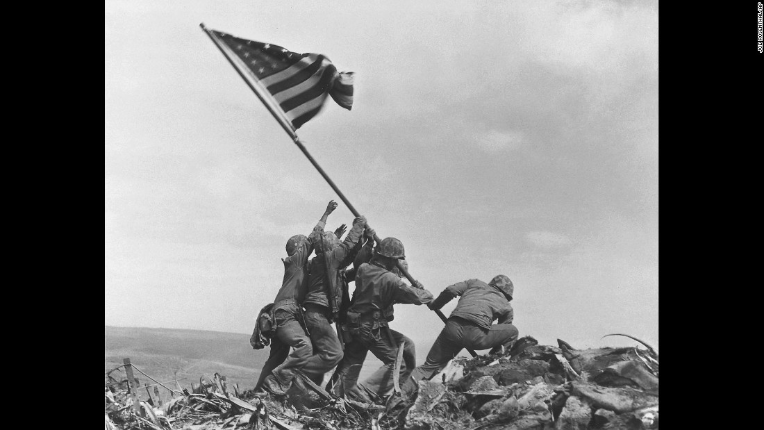 U.S. Marines raise the American flag atop Mount Suribachi on February 23, 1945.