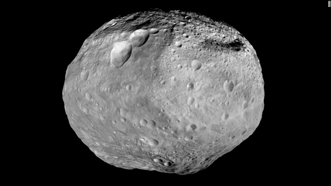 As the spacecraft prepared to leave Vesta behind, scientists created this mosaic of the best views taken during Dawn's stay.