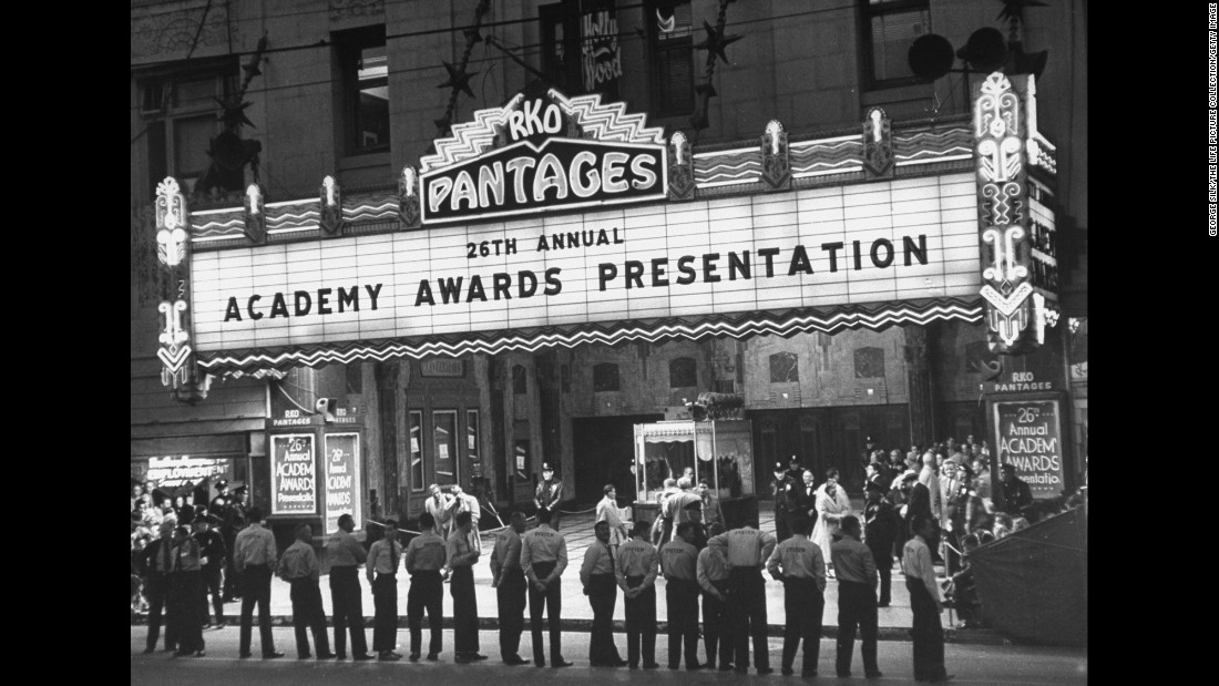 Parking attendants stand in front of Pantages Theatre as they await celebrity attendees to arrive for the 26th Academy Awards in Los Angeles in 1954.