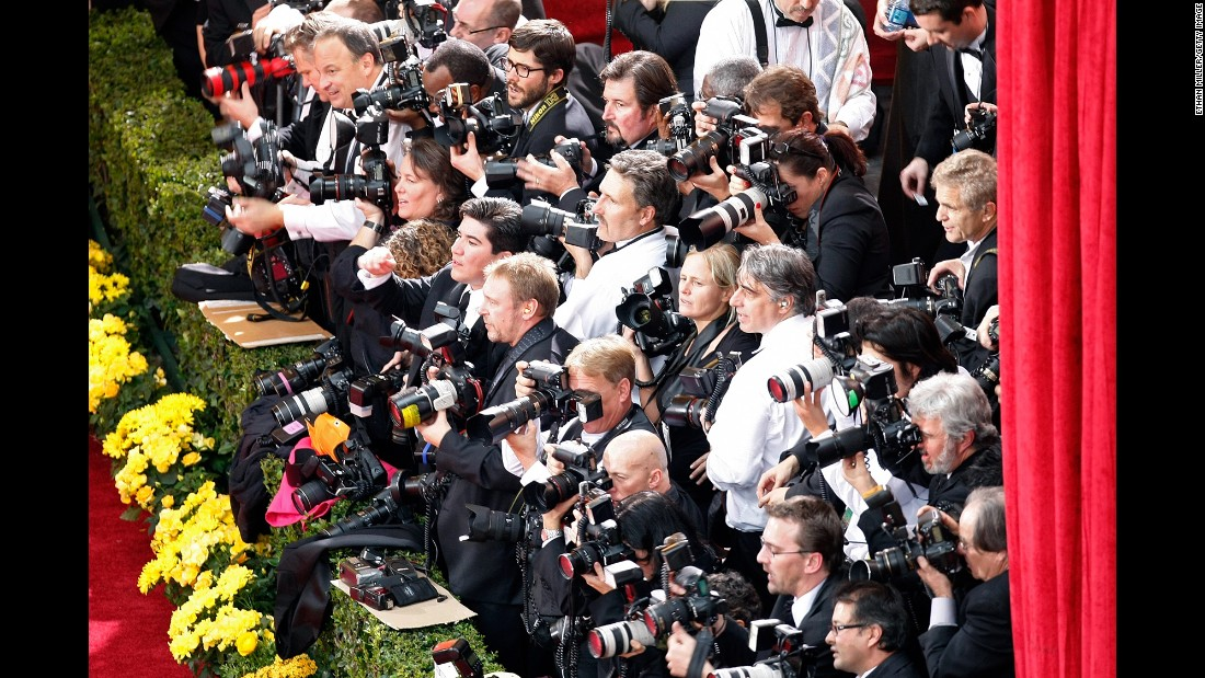 Photographers wait at the edge of the red carpet at the Kodak Theater in February 2009.