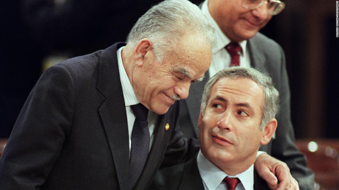 Shamir speaks with Netanyahu at a Middle East peace conference in Madrid in October 1991.