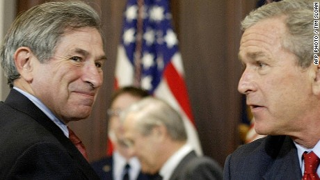Caption:WASHINGTON, UNITED STATES: US President George W. Bush (R) shakes hands with an unidentified person Deputy Defense Secretary Paul Wolfowitz (L) looks on after Bush signed the Department of Defense Appropriations Act for Fiscal Year 2005 at the White House 05 August, 2004 in Washington, DC. AFP PHOTO / TIM SLOAN (Photo credit should read TIM SLOAN/AFP/Getty Images)