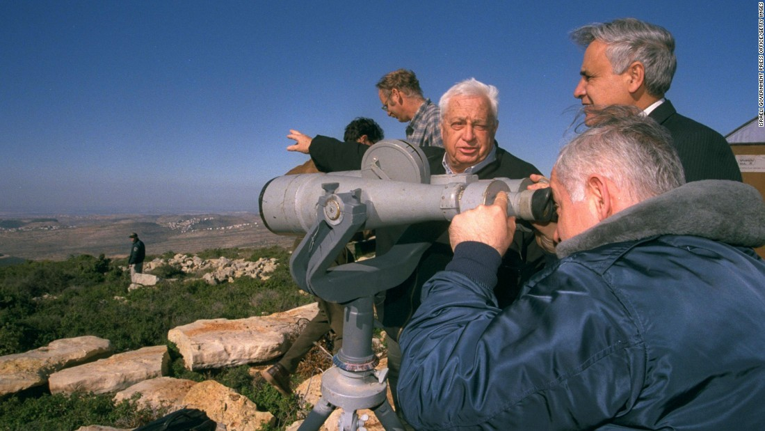 Netanyahu looks through binoculars during a tour of the West Bank with the Israeli Cabinet on December 28, 1997.