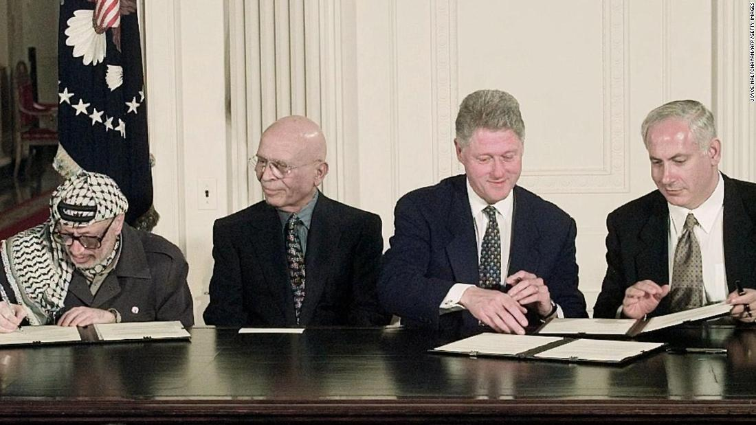 From left, Arafat, King Hussein, U.S. President Bill Clinton and Netanyahu sign an interim Middle East peace agreement in October 1998.
