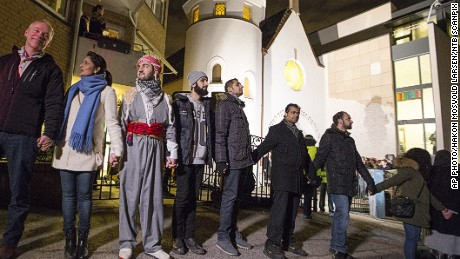 "More than 1,000 people formed a ""ring of peace"" around the Norwegian capital's synagogue, an initiative taken by young Muslims in Norway after a series of attacks against Jews in Europe, in Oslo, Saturday, Feb. 21 2015."