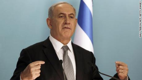 Netanyahu speaks during a press conference in Jerusalem on December 2, 2014. Netanyahu called for early elections as he fired two key ministers in his coalition for opposing government policy.