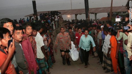 Bangladeshi rescue workers carry a body recovered after a ferry accident Sunday on the Padma River.