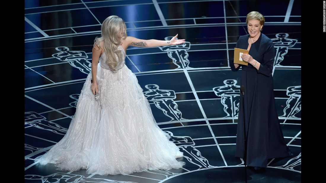 "Lady Gaga introduces Julie Andrews after singing a tribute to ""The Sound of Music."""