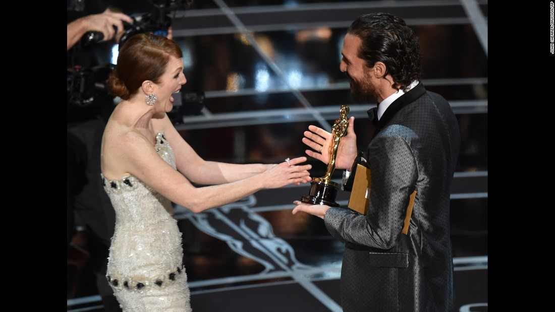 "Matthew McConaughey presents Julianne Moore with the Oscar for best actress at the 87th Academy Awards in 2015. She won for her role in ""Still Alice."""