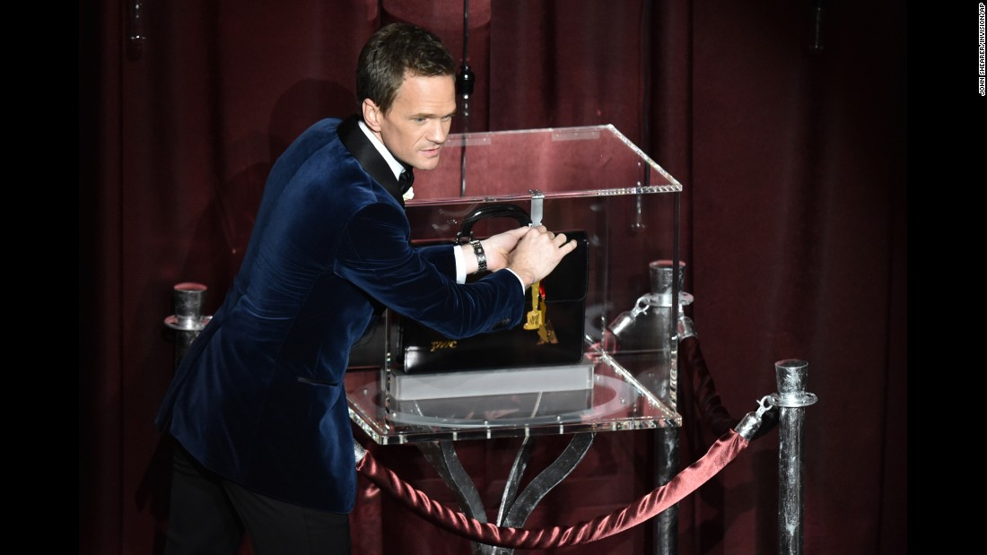 Host Neil Patrick Harris presents his Oscar predictions, which were kept locked in a briefcase on stage during the show.