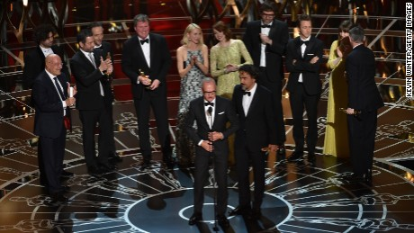 "Michael Keaton and director Alejandro Gonzalez Inarritu accept the award for best picture along with other members of the cast and crew of ""Birdman."" The film also won three other honors: directing, cinematography and original screenplay."