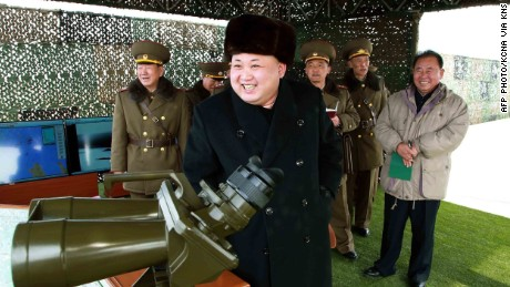 This undated picture released from North Korea's official Korean Central News Agency (KCNA) on February 21, 2015 shows North Korean leader Kim Jong-Un (C) inspecting a drill for striking and seizing island at an undisclosed location in North Korea.
