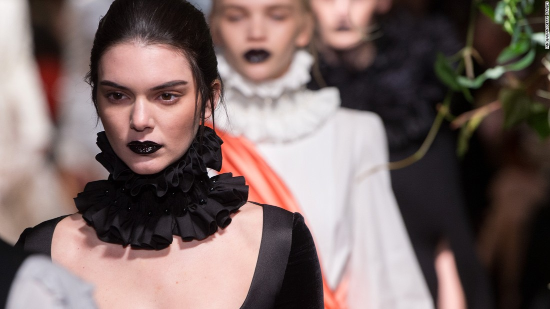 Kendall Jenner, kid sister to Kim Kardashian and a rising model, attracted her share of photos as she took to the runway at Giles. (Fellow model and BFF Cara Delevingne was in the audience to show her support.)