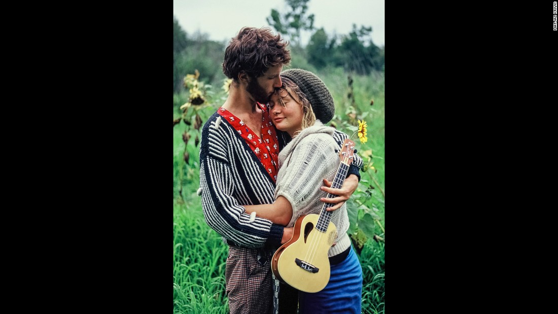 Two people embrace at a Rainbow Gathering in Hungary in 2014. Photographer Matjaz Krivic captured moments at gatherings over a span of 19 years at Rainbow Gatherings in various countries.