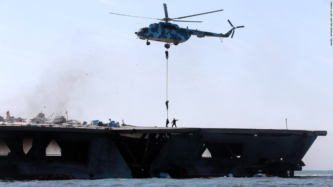 Iran's elite Revolutionary Guard troops rappel down a helicopter onto the vessel.