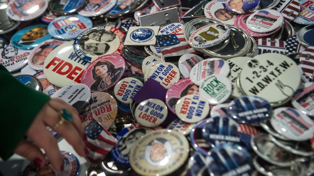 A woman browses through conservative politicas badges at the annual Conservative Political Action Conference.