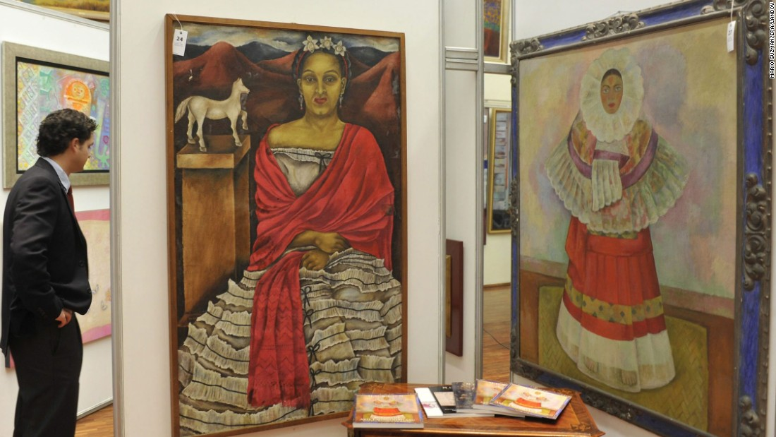 "Painter <a href=""http://clara.nmwa.org/index.php?g=entity_detail_print&entity_id=3933"" target=""_blank"">Maria Izquierdo</a> (1902-55), whose self-portrait is shown on the left, was inspired by Mexican folklore. Among her admirers was fellow Mexican artist Diego Rivera, whose work is shown on the right. Her 1930 solo show in New York was the first one-person exhibition in the United States to feature the work of a Mexican woman. Born in 1902, Izquierdo grew up in a rural village before moving to Mexico City in 1923. Several years later, she became a student at the city's Escuela Nacional de Bellas Artes, which is geo-tagged in the Google app."