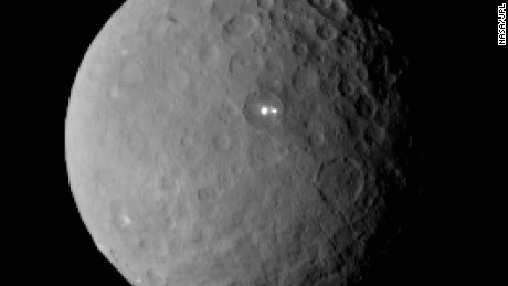NASA's Dawn spacecraft took this image of dwarf planet Ceres on February 19, 2015 from a distance of nearly 29,000 miles (46,000 kilometers). A bright spot with a dimmer companion spot can be seen. They appear to be in the same basin. Dawn will be captured into orbit around Ceres on March 6.