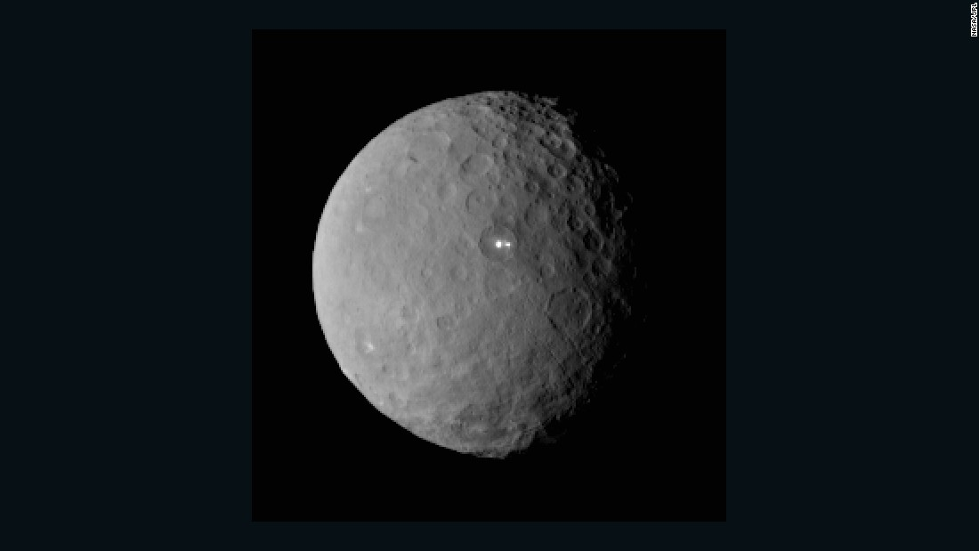 """Ceres has really surprised us,"" said Carol Raymond, Dawn's deputy principal investigator. ""The first images have produced some really puzzling features."" One of the puzzles: two bright white spots that showed up in photographs taken by Dawn on February 19."