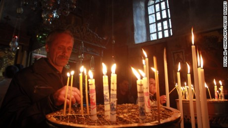 Christians light candles last month in the Church of the Nativity in the West Bank town of Bethlehem, the birthplace of Jesus.