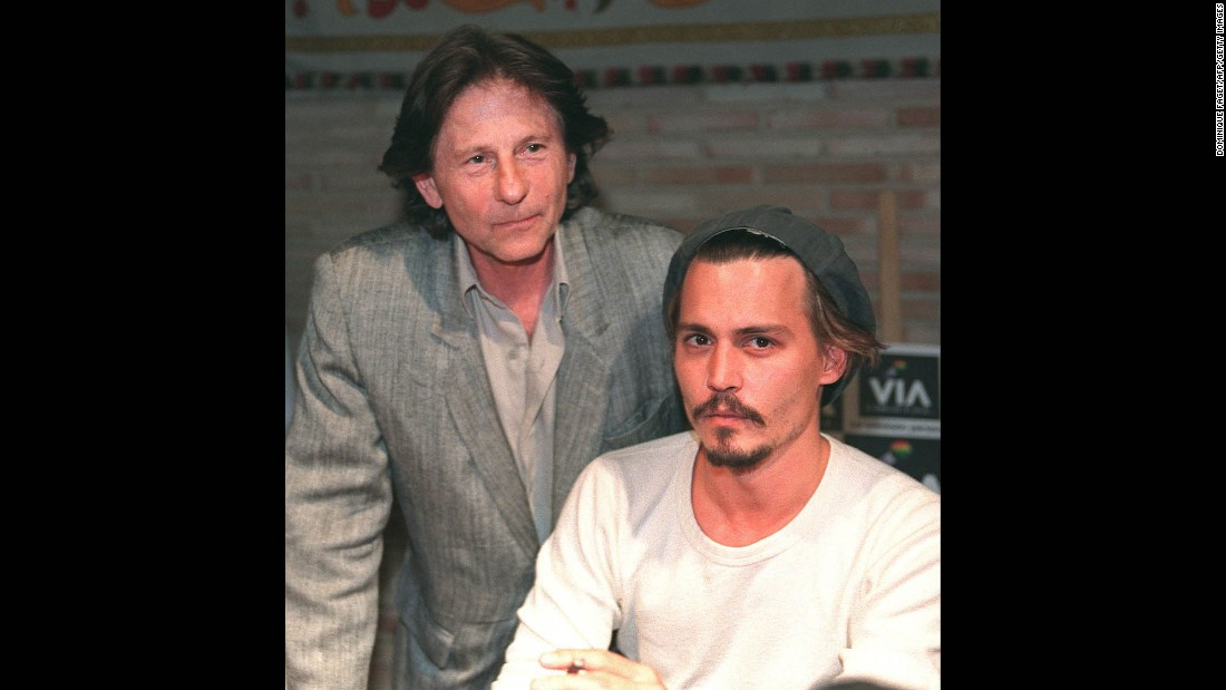 "Polanski stands behind actor Johnny Depp during a press conference in Toledo, Spain, in 1998. The pair were shooting the film ""The Ninth Gate"" in Toledo."