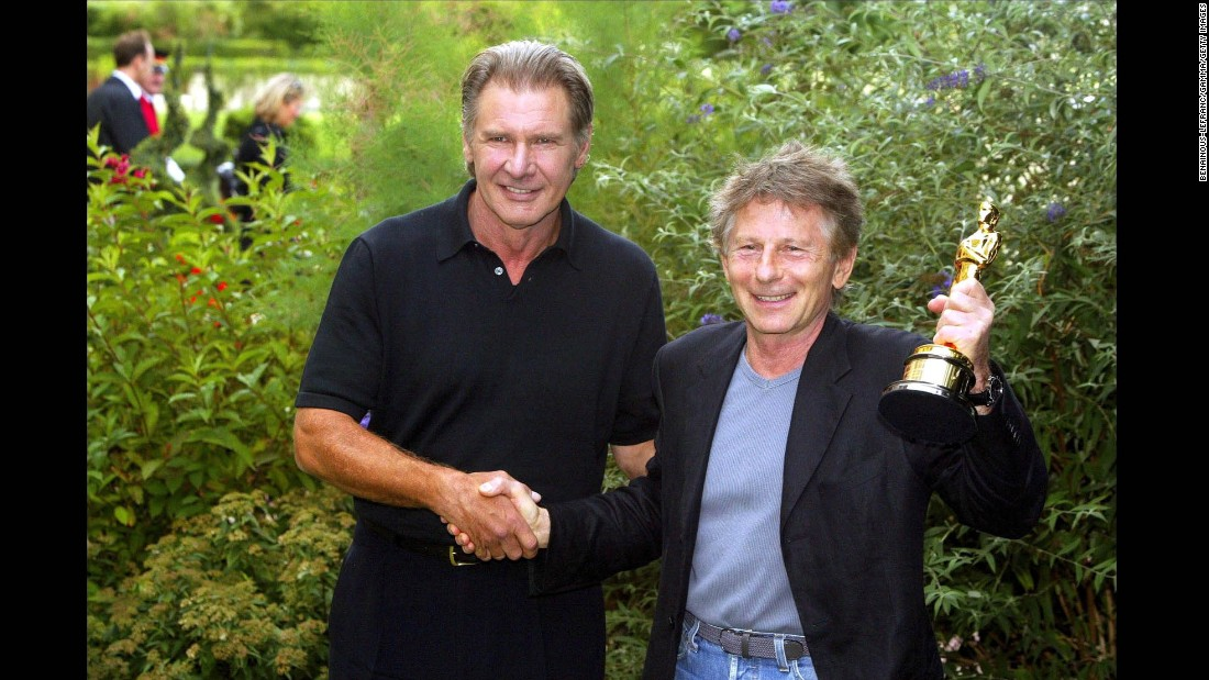 "Polanski receives his 2003 Academy Award for best director for ""The Pianist"" from Harrison Ford in France."