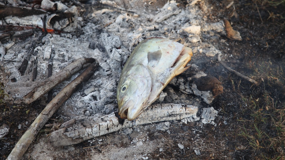 The fish -- head and collar -- is thrown directly on a fire on the beach, and when cooked, eaten with fingers. It's delicious.