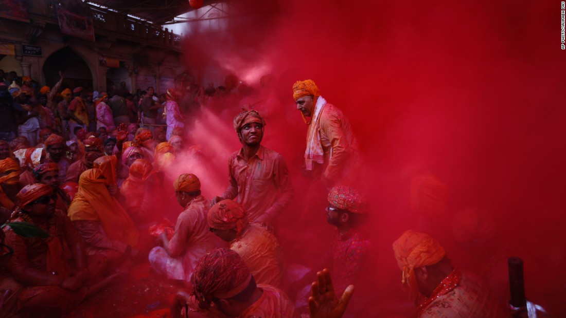 "FEBRUARY 27 -- BARSANA, INDIA: Hindu men from the village of Nandgaon throw colored powder at each other as part of the region's Lathmar Holi festivities. During Lathmar Holi, men from Nandgaon -- said to be the home of the Hindu god Krishna -- tease women from neighboring Barsana -- the home of Krishna's consort, Radha. In response, Barsana's women ""beat"" the men with wooden sticks."