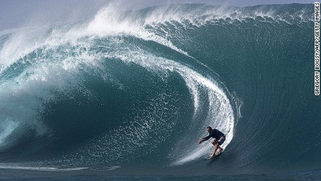 US surfer Laird Hamilton rides a wave at Teahupoo in Tahiti on May 14, 2013. Top surfers in the world gathered in Teahupoo since the beginning of the week to ride waves up to 8 metres high. AFP PHOTO/GREGORY BOISSY (Photo credit should read GREGORY BOISSY/AFP/Getty Images)