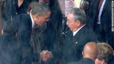 JOHANNESBURG, SOUTH AFRICA - DECEMBER 10:  (EDITORS NOTE: Retransmission of #454753083 with alternate crop.) U.S. President Barack Obama (L) shakes hands with Cuban President Raul Castro during the official memorial service for former South African President Nelson Mandela at FNB Stadium December 10, 2013 in Johannesburg, South Africa. Over 60 heads of state have travelled to South Africa to attend a week of events commemorating the life of former South African President Nelson Mandela. Mr Mandela passed away on the evening of December 5, 2013 at his home in Houghton at the age of 95. Mandela became South Africa's first black president in 1994 after spending 27 years in jail for his activism against apartheid in a racially-divided South Africa.  (Photo by Chip Somodevilla/Getty Images)