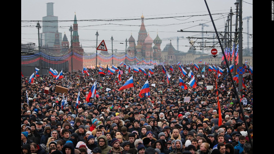 People march in memory of Nemtsov in Moscow on Sunday, March 1.